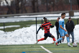 SU senior forward Chris Nanco tracks down a North Carolina defender. The Orange was 17-0 when Nanco scored in a game. He couldn't find the back of the net on Sunday.