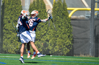 Two Syracuse players celebrate together.
