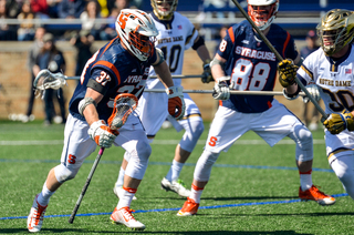 Ben Williams runs toward the net. He won 43 percent of his faceoffs.